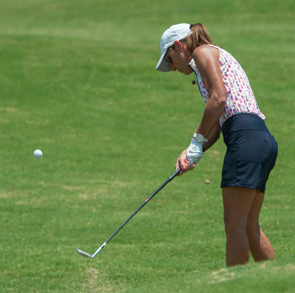 Janel Meyer chips toward the green 06/09/2021 during the second round of the Women's West Texas Tournament at Midland Country Club. Tim Fischer/Reporter-Telegram