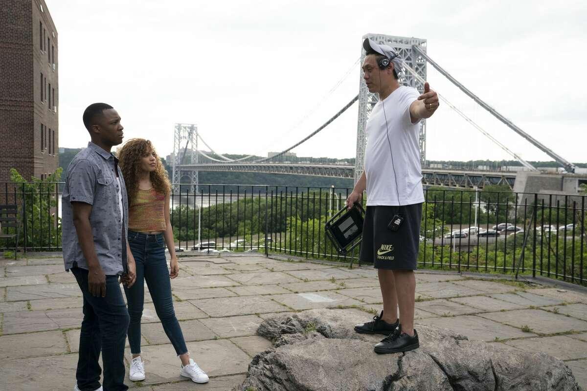 Corey Hawkins, Leslie Grace and director Jon M. Chu on the set of