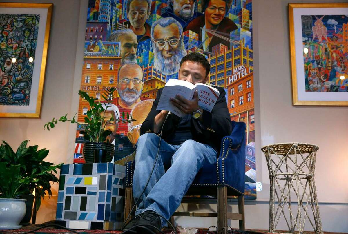 Former supervisor David Campos reads text from the Mueller Report during a collaborative all-day reading of the entire report at Manny's cafe and community meeting room in San Francisco, Calif. on Thursday, June 6, 2019. The cafe was tagged with anti-Zionst, pro-Palestinian graffiti over the weekend.