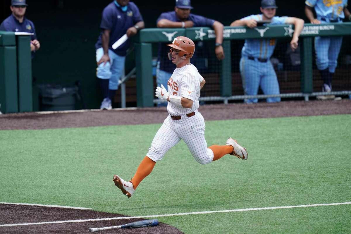 Texas outfielder Mike Antico (5) scores against Southern in the first inning of Game 1 of the NCAA college baseball regional tournament, Friday, June 4, 2021, in Austin, Texas. (AP Photo/Eric Gay)