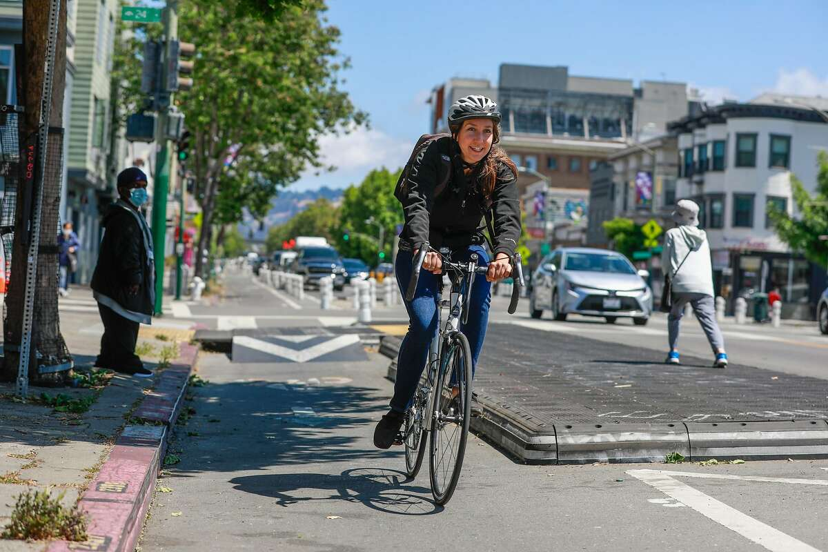 A cyclist rides in the bike lane on Telegraph Avenue in Oakland. The city's Department of Transportation wants the city council to remove protected bike lanes on a nine-block downtown corridor on Telegraph Avenue.