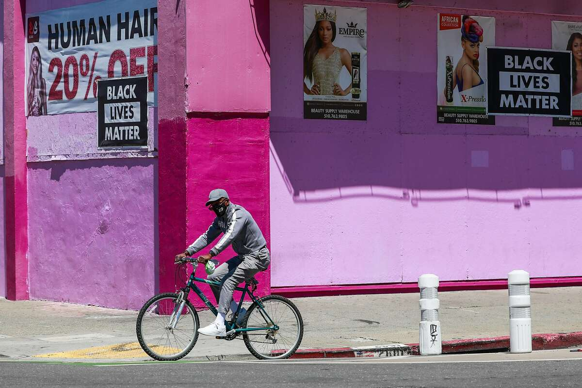 A cyclist rides in the bike lane on Oakland's Telegraph Avenue. Oakland Department of Transportation says the protected lanes from 20th to 29th Streets simply are not working, creating visibility issues for drivers.