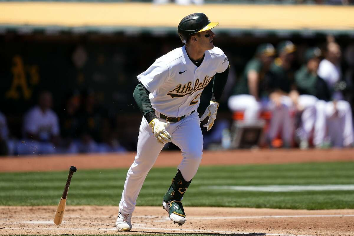 Oakland Athletics' Mark Canha hits a triple to drive in two runs against the Arizona Diamondbacks during the second inning of a baseball game Wednesday, June 9, 2021, in Oakland, Calif. (AP Photo/Tony Avelar)