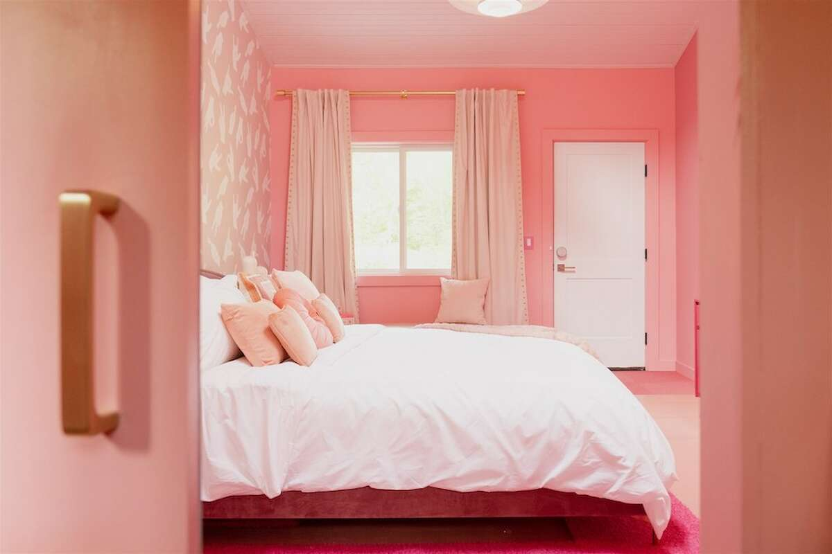In addition to wall-to-wall color themes, each room has a specific style, too. The pink room is