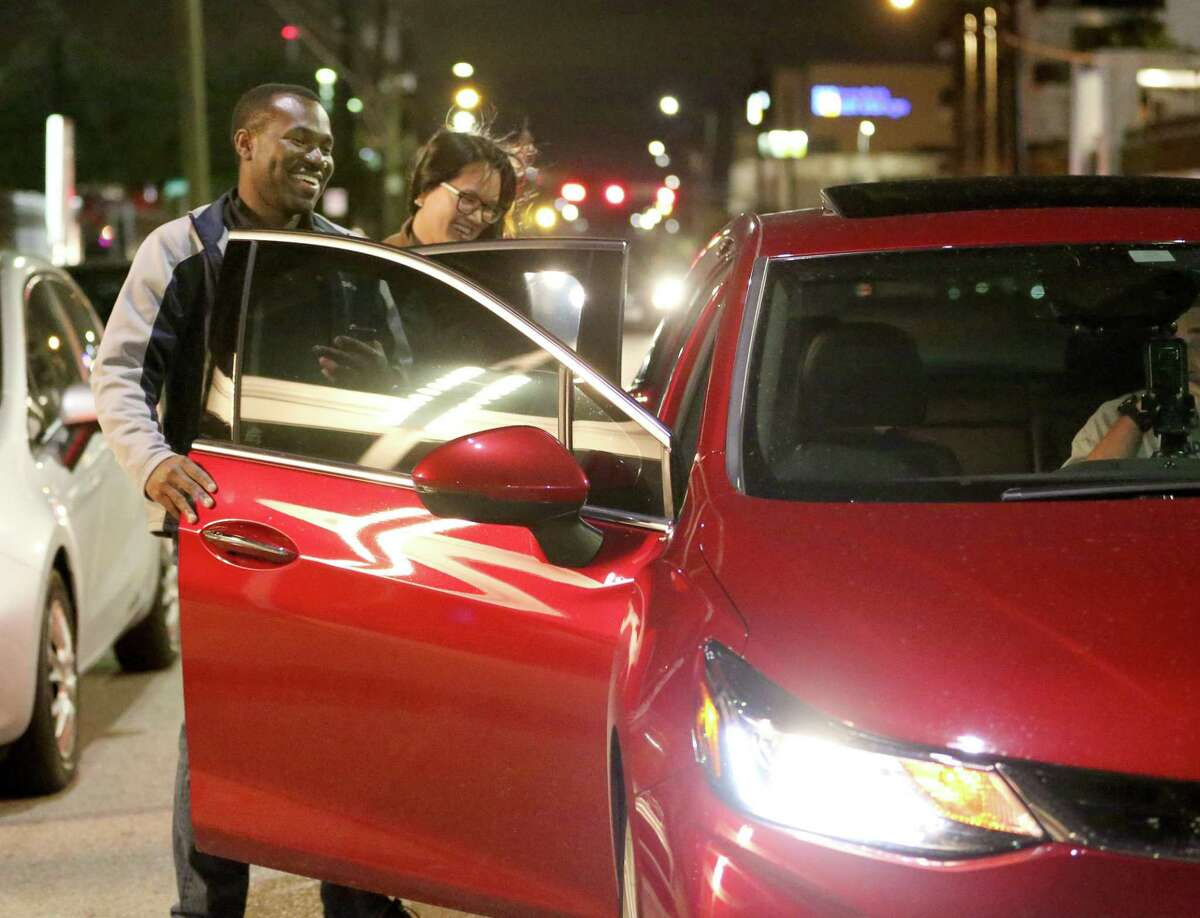 Manny Amoabeng, left, and Angela Bui get in a Uber ride as they are leaving Kung Fu Saloon on Washington Avenue on Nov. 18, 2016, in Houston. Many revelers hail rides to bars, which has led to fewer severe injuries from road crashes.