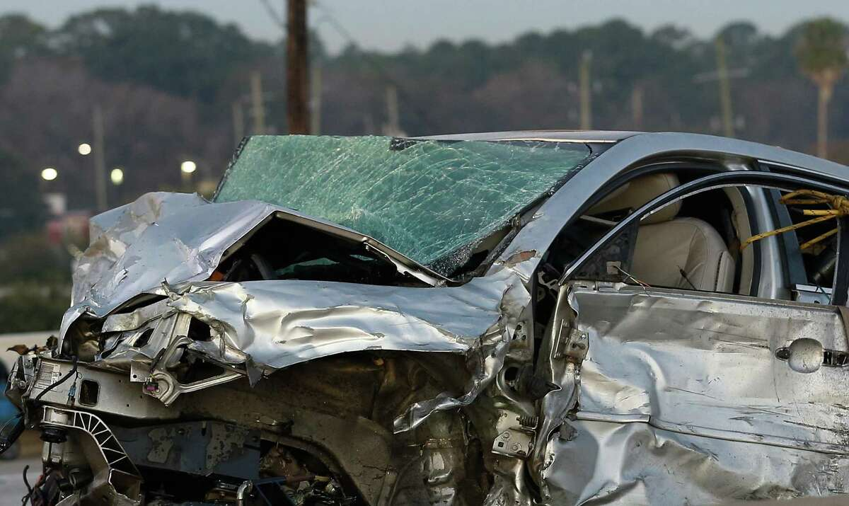 A smashed car involved in a three-vehicle wrong-way fatal crash on 13919 North Freeway southbound is towed away on Dec. 19, 2020, in Houston. One driver was killed and the at-fault driver was charged with intoxication manslaughter.