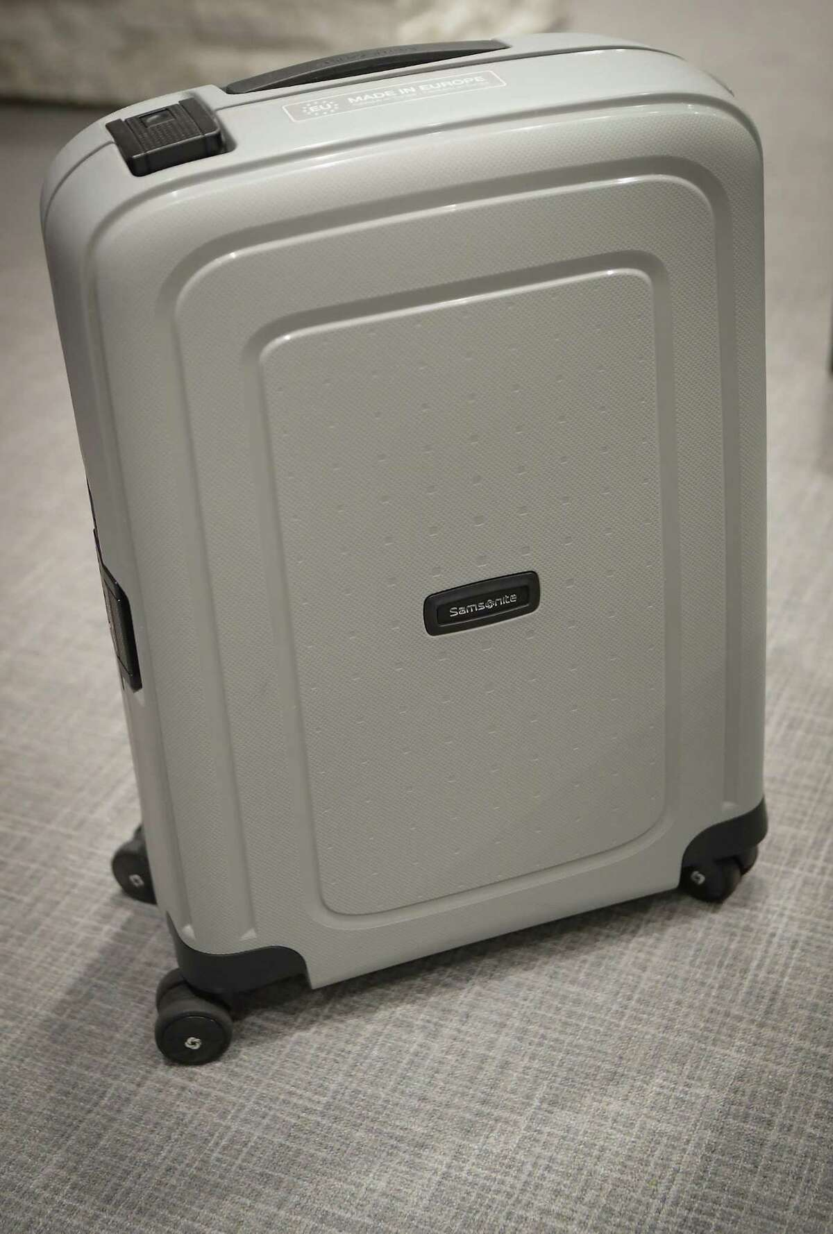 A Samsonite luggage made from recycled plastics is shown by Bob Patel, CEO of LyondellBasell chemical industry company Thursday, June 3, 2021, in Houston.