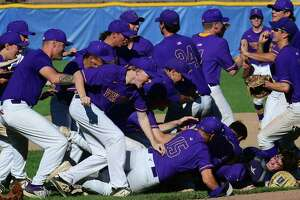 Vikings celebrate their win as the Brien McMahon High School Senators take on the Westhill High School Vikings in their Class LL baseball semifinal game Wednesday, June 9, 2021, at Cubeta Stadium in Stamford, Conn.