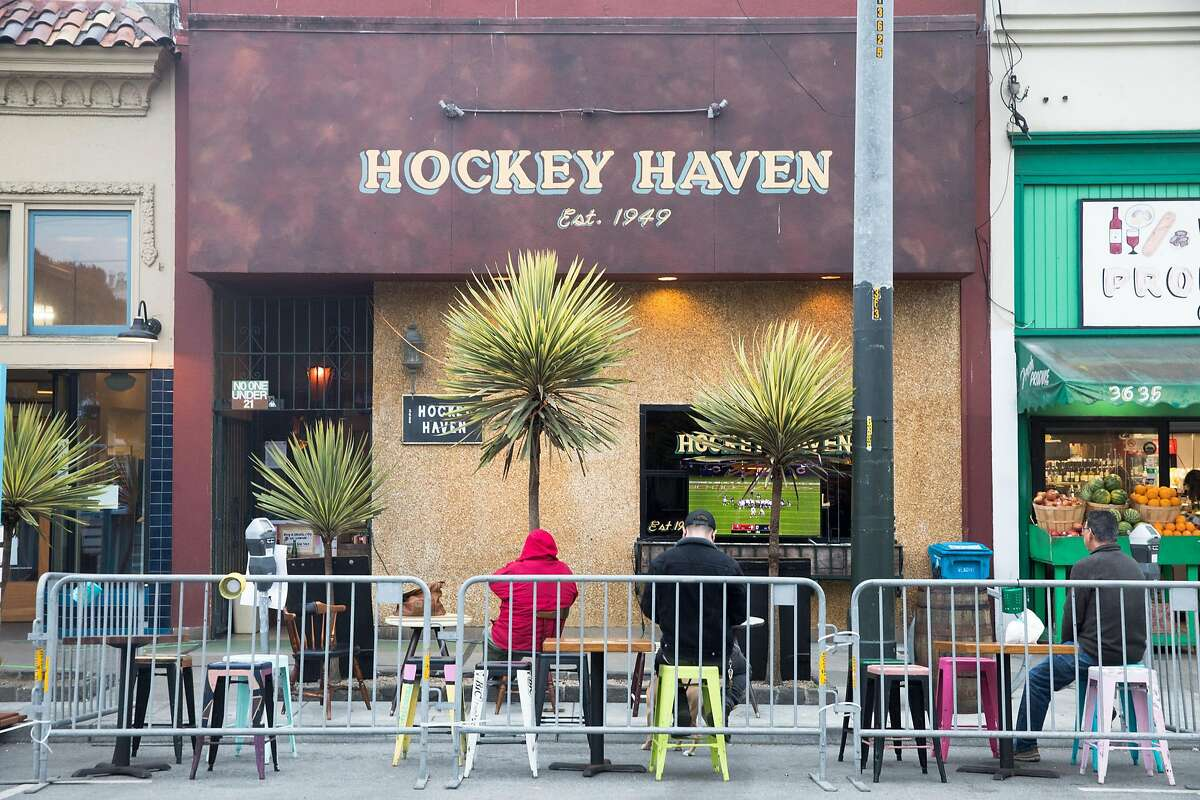 Patrons dine and have drinks outside Hockey Haven in their outdoor seating in San Francisco on Oct. 8, 2020.
