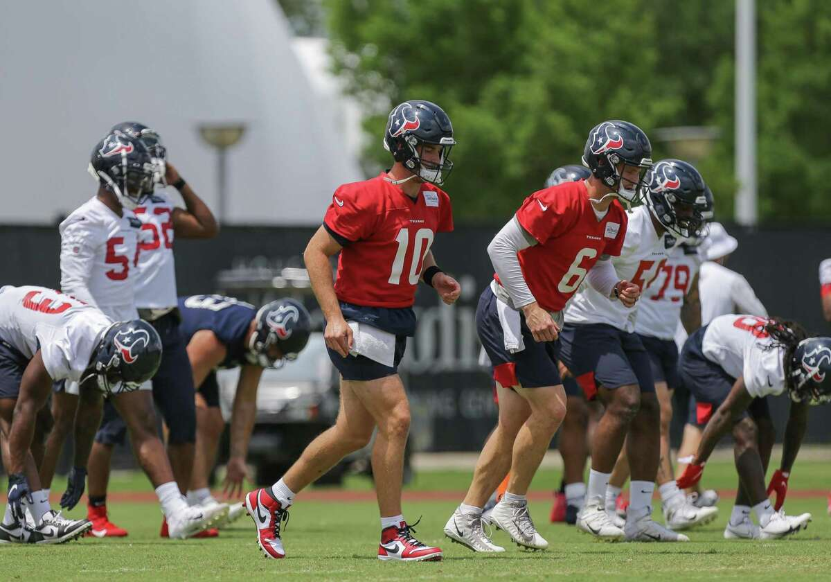 Houston Texans quarterbacks Davis Mills (10) and Jeff Driskel (6) stretch at the beginning of an OTA practice at Houston Methodist Training Center on Wednesday, June 9, 2021, in Houston.
