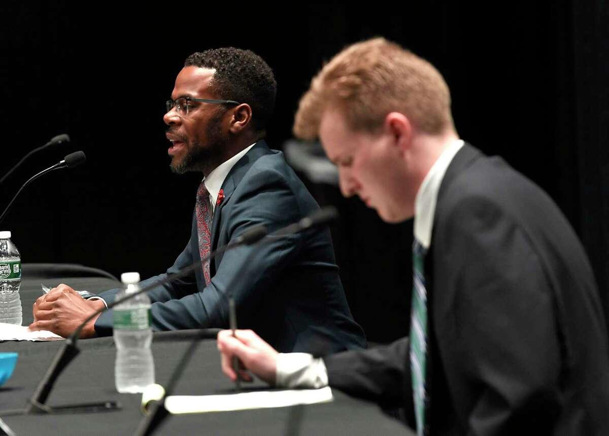 Schenectady County Legislator candidates Omar McGill, left, and Brendan Savage are seen during a forum at Proctors between Schenectady City Council and County Legislator candidates ahead of June 22 Democratic primary on Wednesday, June 9, 2021 in Schenectady, N.Y. (Lori Van Buren/Times Union)