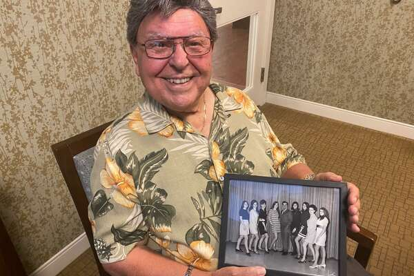 Don Scinto shows off a photo from his days performing at the Polka Dot Playhouse in his hometown of Bridgeport.