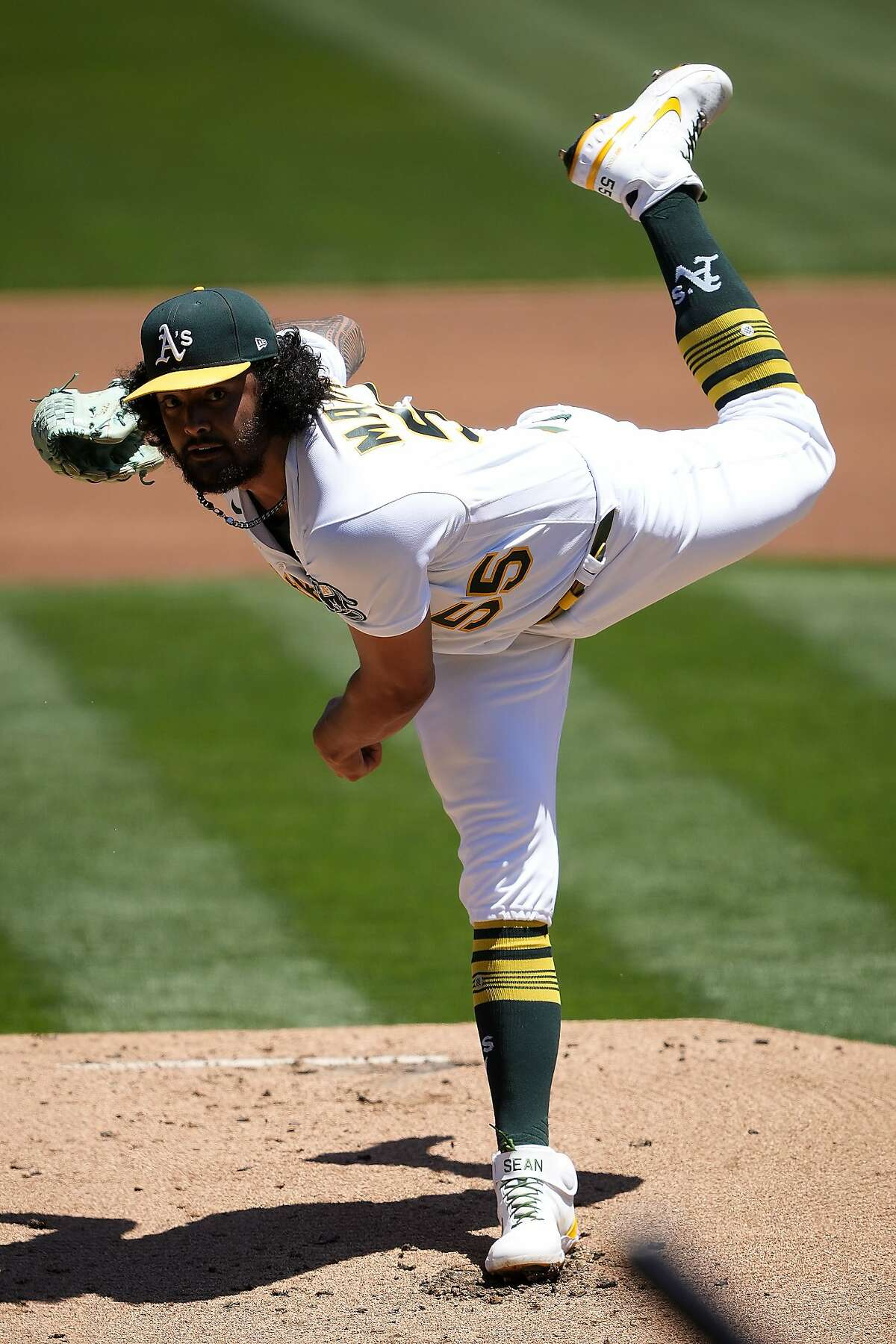 Oakland Athletics starting pitcher Sean Manaea throws against the Arizona Diamondbacks during the first inning of a baseball game Wednesday, June 9, 2021, in Oakland, Calif. (AP Photo/Tony Avelar)