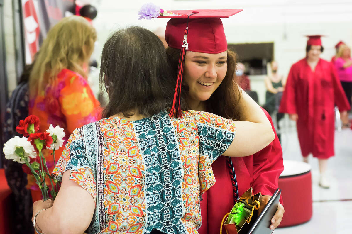 Susan Knapp receives her diplomas as the Windover High School Class of 2021 celebrates with a commencement ceremony Wednesday, June 9, 2021 at the school in Midland. (Katy Kildee/kkildee@mdn.net)