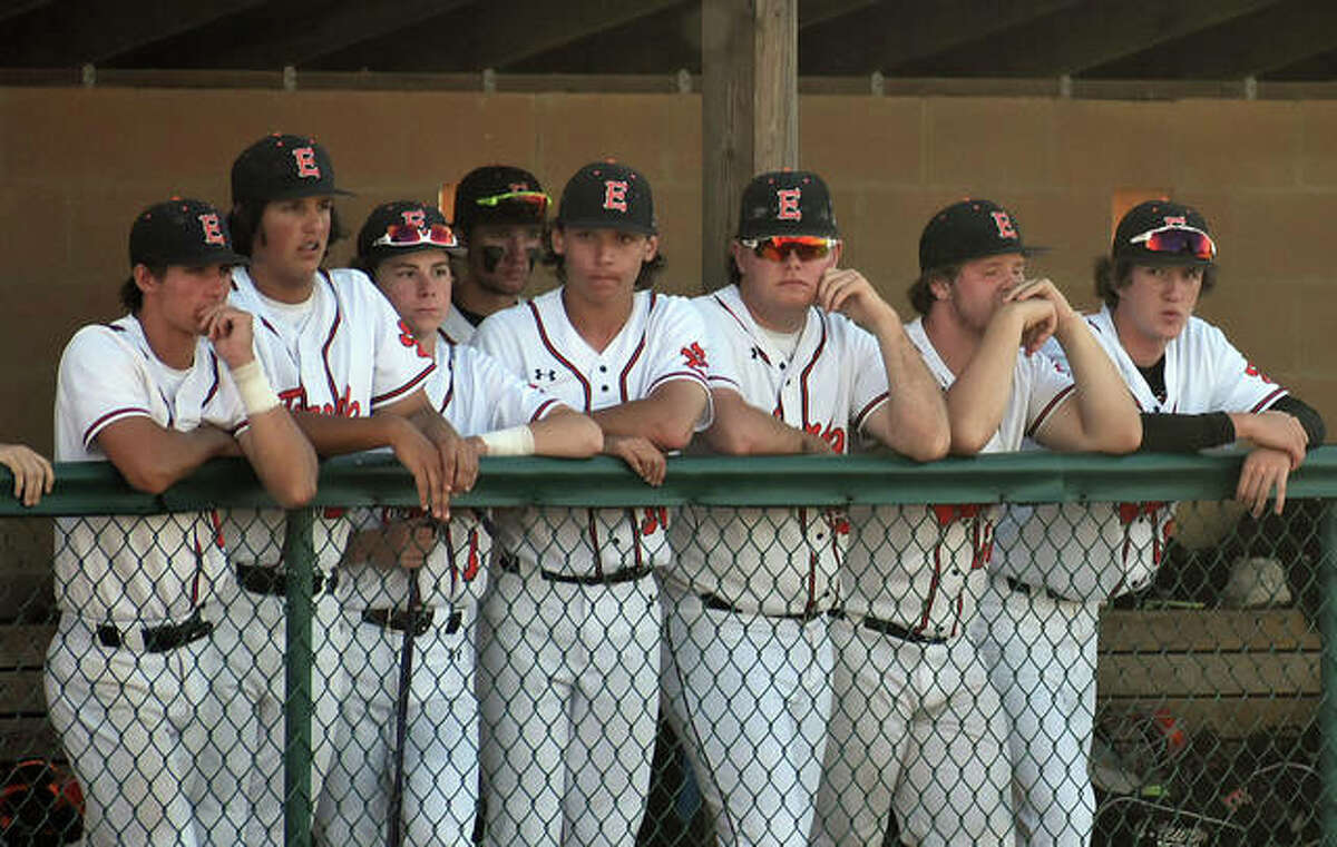 Members of the EHS Tigers watch from the dugout after their season wrapped up with a loss to O'Fallon in the Class 4A sectional semifinals on Wednesday at Tom Pile Field.