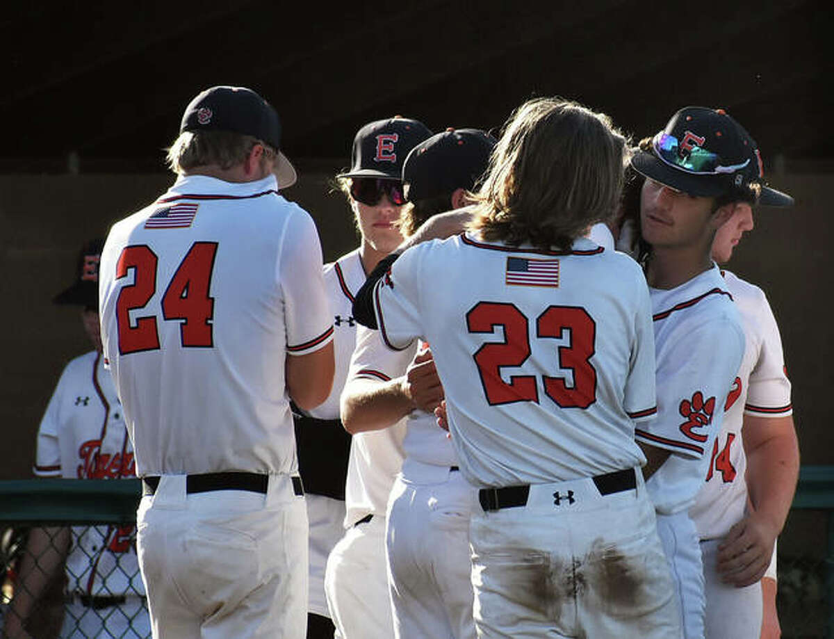 Members of the EHS Tigers embrace after their season wrapped up with a loss to O'Fallon in the Class 4A sectional semifinals on Wednesday at Tom Pile Field.
