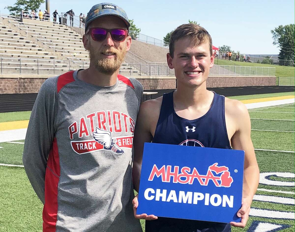 Unionville-Sebewaing Area track and field coach Mike Peter poses with state champion runner Bentley Alderson.