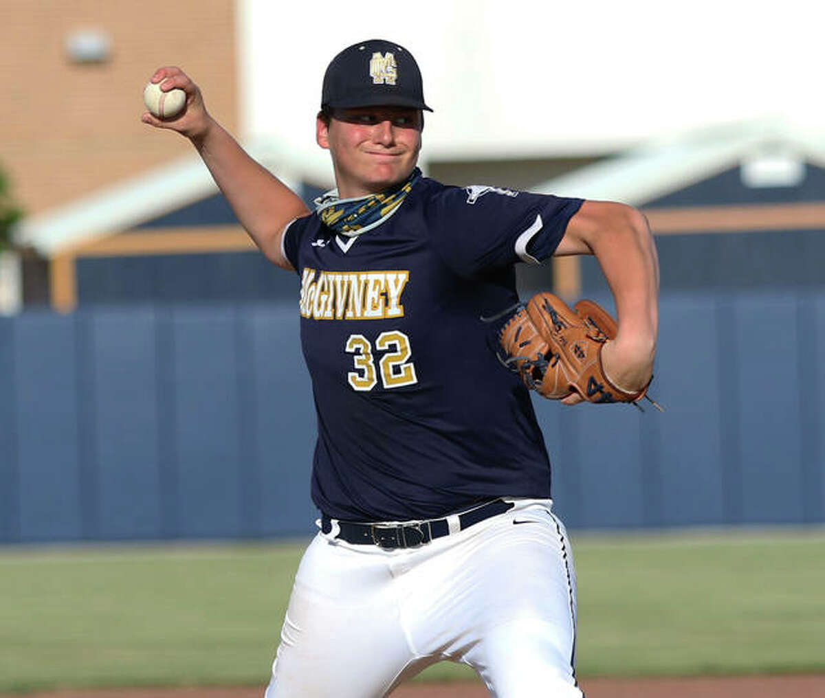 Father McGivney starting pitcher Gabe Smith delivers a pitch to a Carrollton hitter during a Class 1A sectional semifinal game.