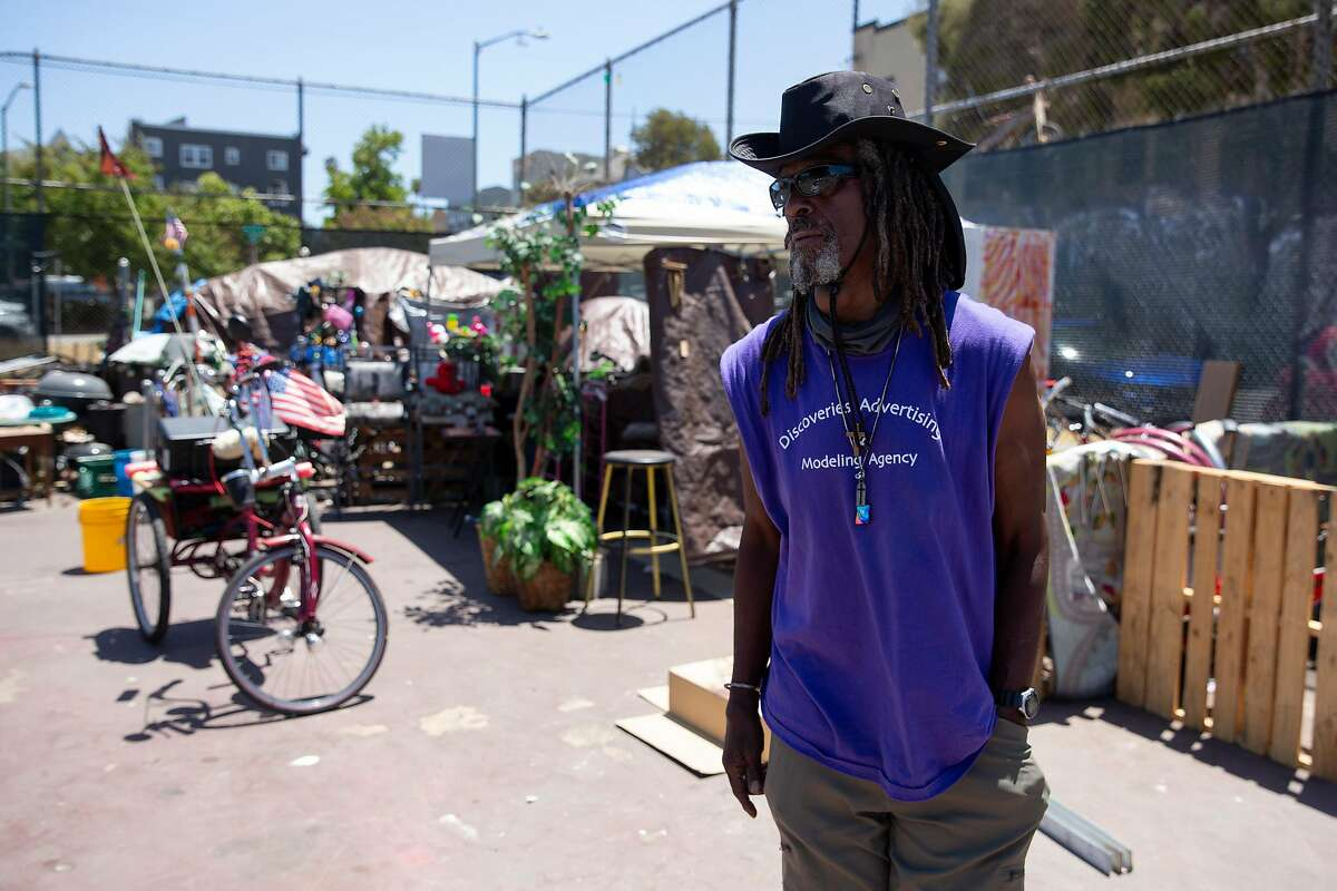 Parker operates a makeshift bike repair business out of his tent at the Athol Tennis Courts in Oakland. The 67-year-old and other homeless advocates have started meetings with residents.