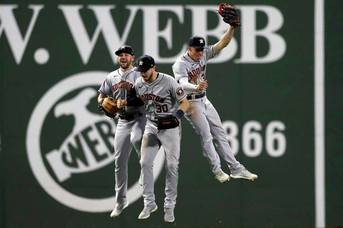 Houston Astros' Chas McCormick, left, Kyle Tucker (30) and Myles Straw (3) celebrate after Astros defeated the Boston Red Sox in a baseball game Wednesday, June 9, 2021, in Boston. (AP Photo/Michael Dwyer)
