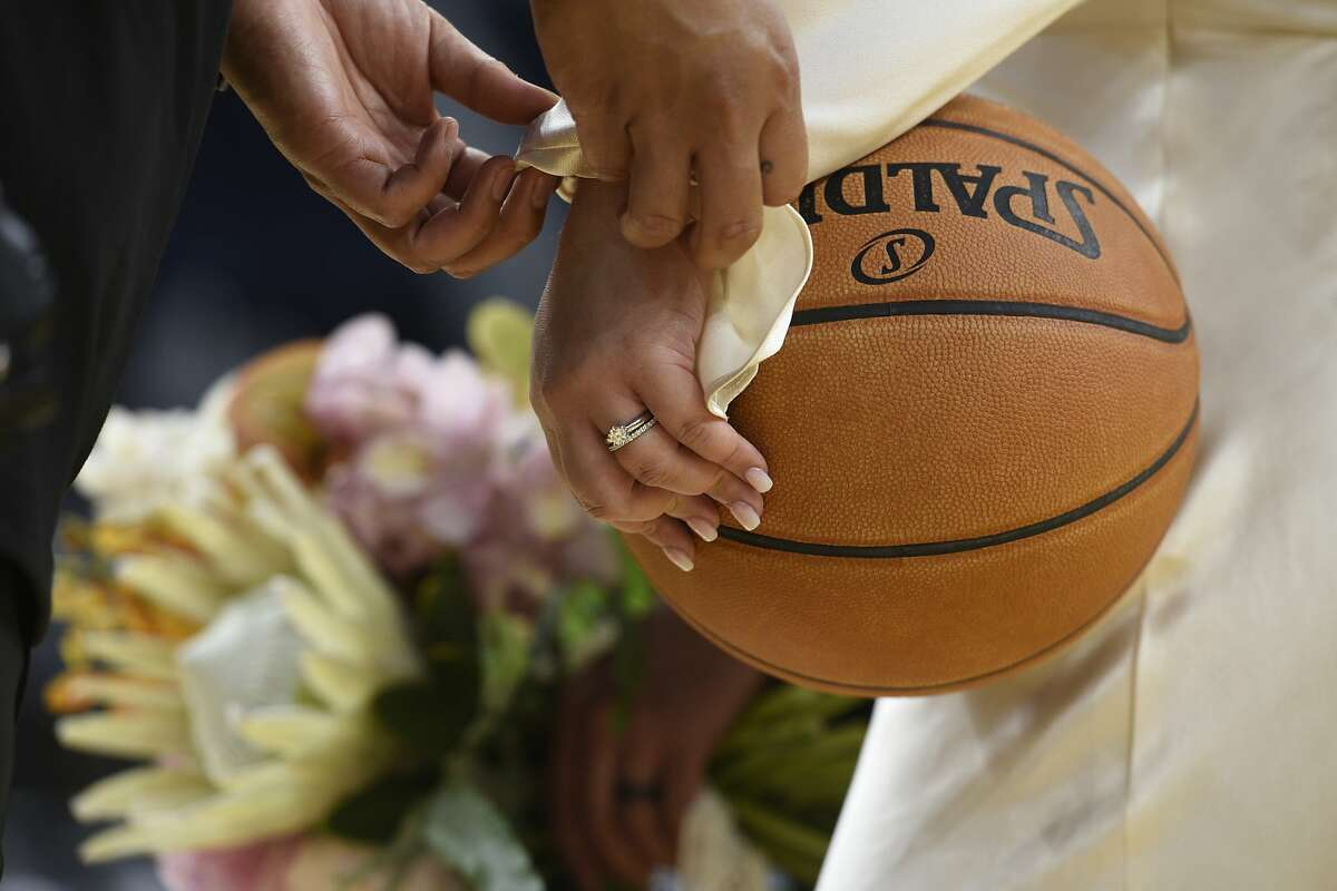 While posing for wedding photographs, bridegroom Fiel put up some shots from the basketball court at Chase Center. He went 3 for 15.