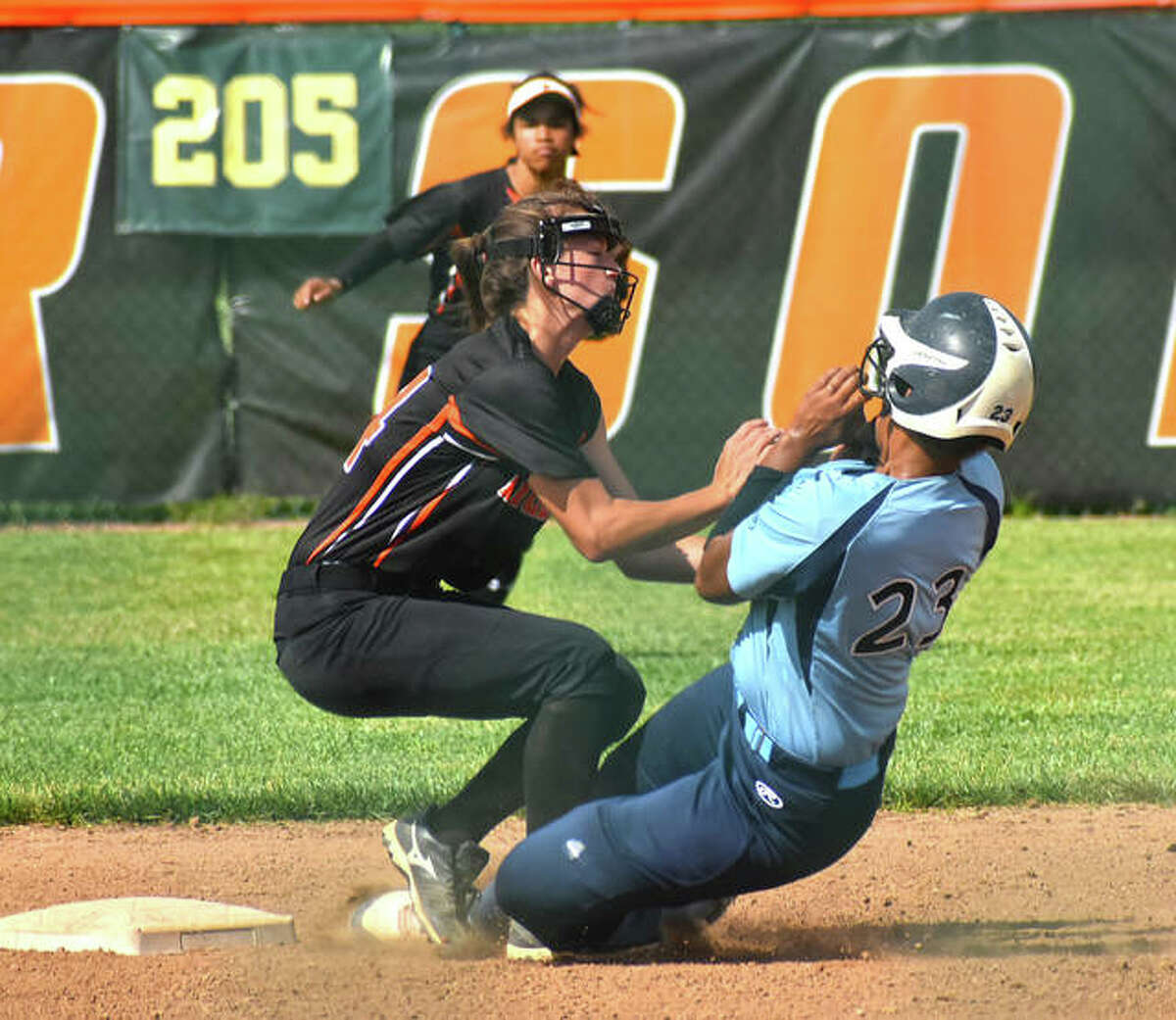 Edwardsville shortstop Tatum VanRyswyk tags out a would-be base stealer at second base in the first inning Wednesday inside the District 7 Sports Complex.