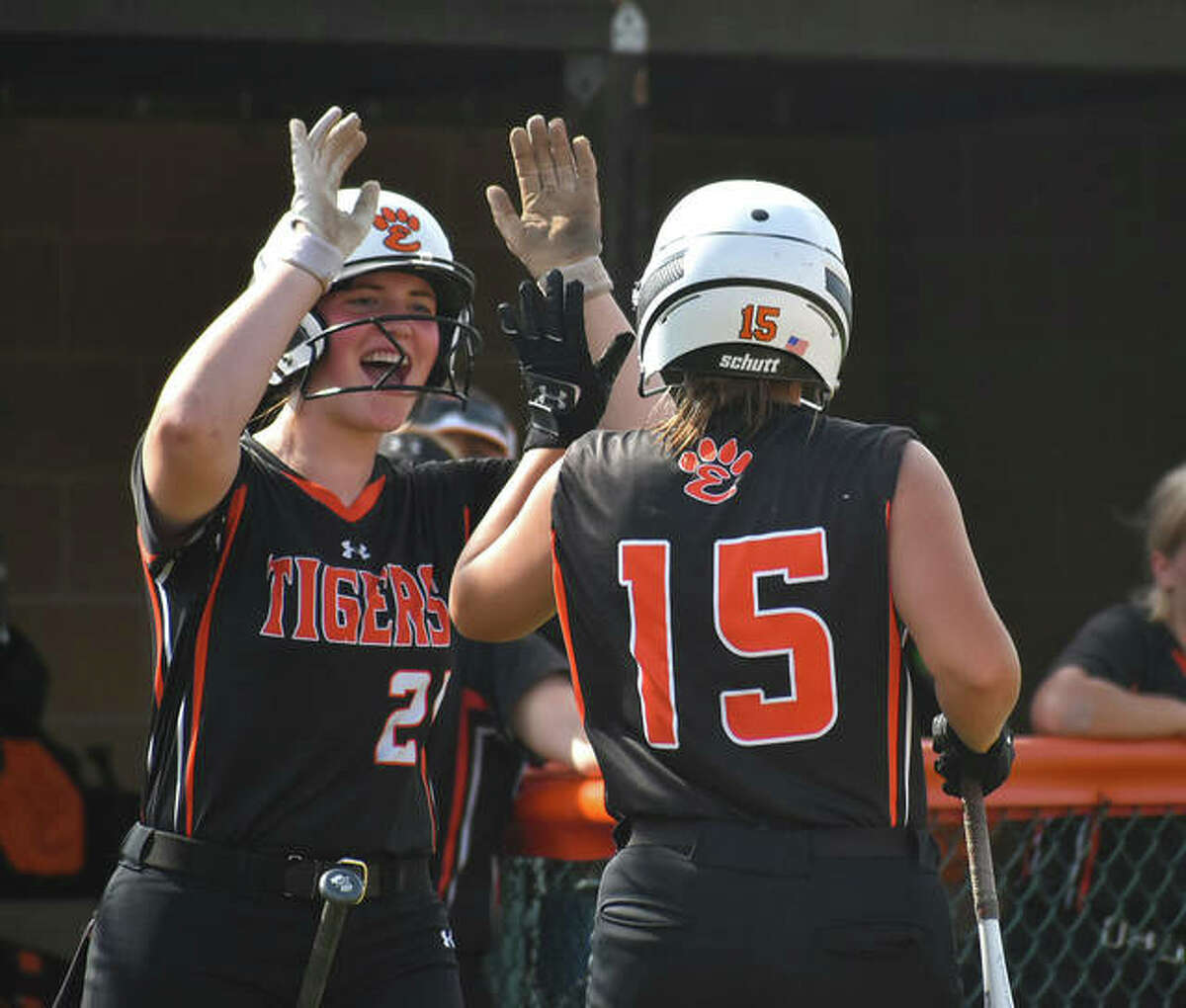 Edwardsville's Lexie Griffin congratulates Sydney Lawrence after driving in a run in the first inning.