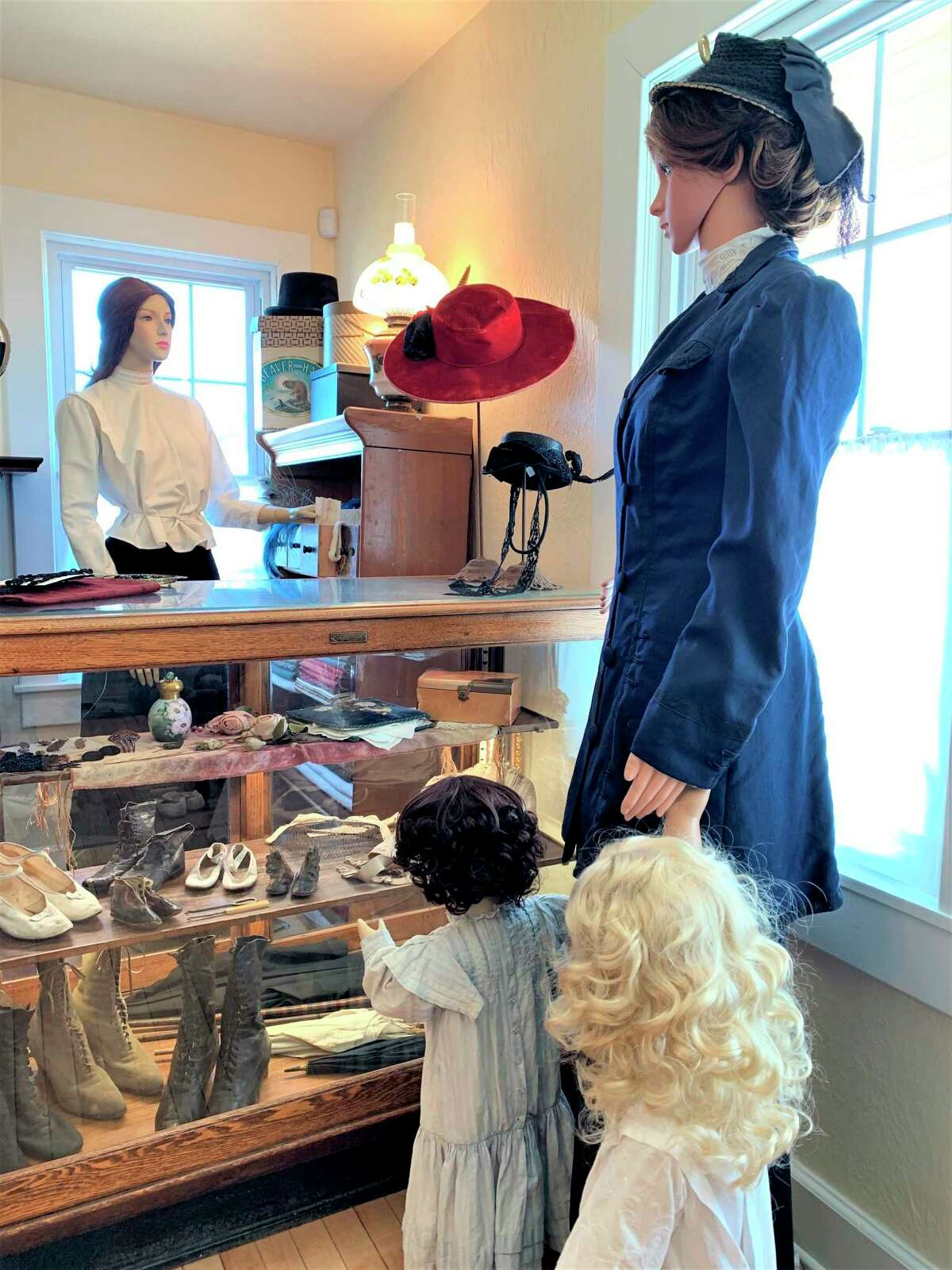 Pictured is a dressmaking exhibit from the 1890-1910 era that is on display at the Lake County Historical Museum and Research Library. (Courtesy photo)