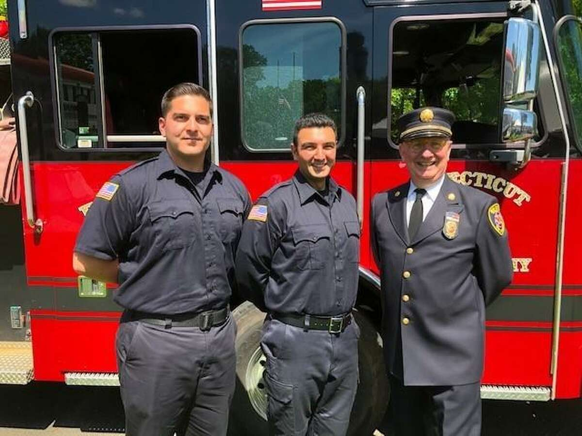 Graduation exercises for the Connecticut Fire Academy were held Thursday, May 26, 2021 in Windsor Locks. Shown above are the graduates from New Canaan: Michael A. Esposito, and Barry Setayesh, (left to right,) with Jack Horner, New Canaan Fire Commission chairman. Esposito, and Setayesh began on Tuesday, June 1, with the New Canaan Fire Department.