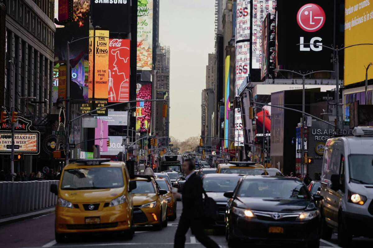 Vehicles sit in traffic during rush hour in the Times Square area of New York on April 2, 2019.