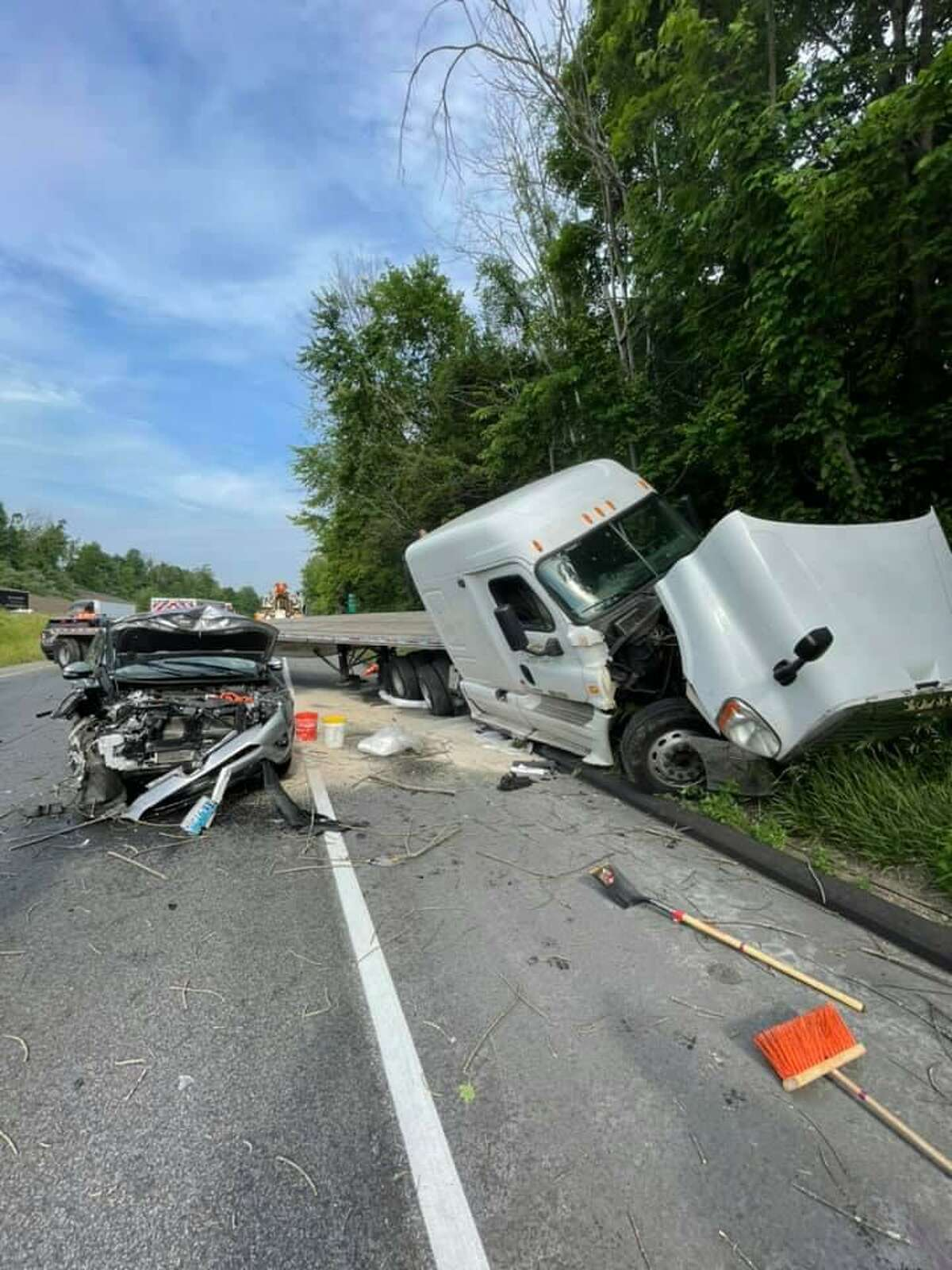 A tractor-trailer driver was found at fault for the crash on I-84 in Newtown that shut down a stretch of highway during Tuesday morning rush hour.