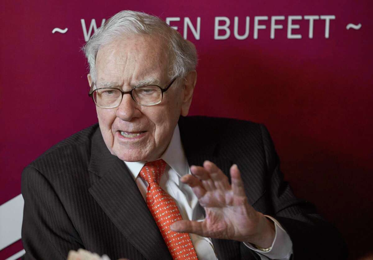 FILE - In this May 5, 2019, file photo Warren Buffett, Chairman and CEO of Berkshire Hathaway, speaks during a game of bridge following the annual Berkshire Hathaway shareholders meeting in Omaha, Neb. The richest 25 Americans pay less in tax - 15.8% of adjusted gross income - than many ordinary workers do, once you include taxes for Social Security and Medicare, the nonprofit investigative journalism organization ProPublica found, Tuesday, June 8, 2021. (AP Photo/Nati Harnik, File)