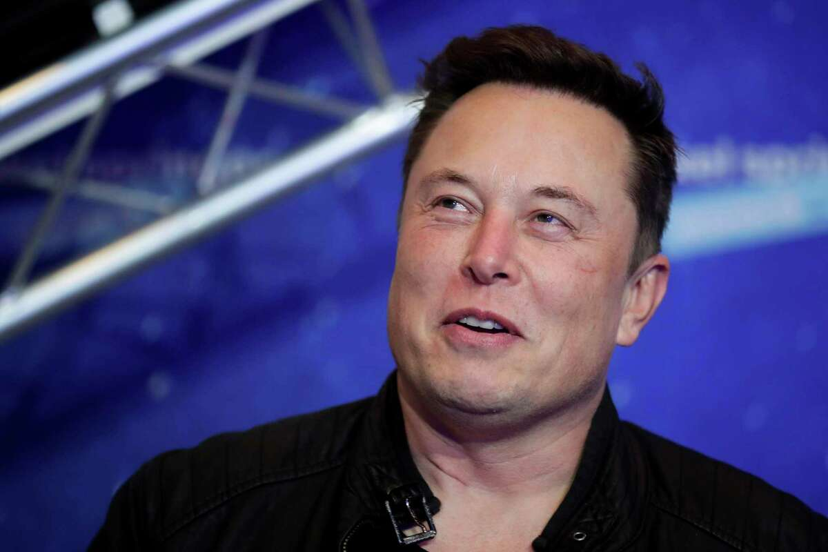 In this Dec. 1, 2020 file photo, SpaceX owner and Tesla CEO Elon Musk arrives on the red carpet for the Axel Springer media award, in Berlin, Germany. The richest 25 Americans pay less in tax - 15.8% of adjusted gross income - than many ordinary workers do, once you include taxes for Social Security and Medicare, the nonprofit investigative journalism organization ProPublica found, Tuesday, June 8, 2021.