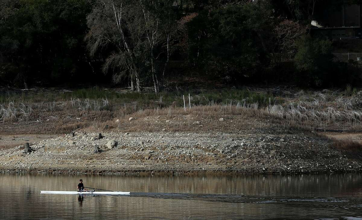 A rower navigates the waters of the Lexington Reservoir on January 28, 2014 in Los Gatos, California.