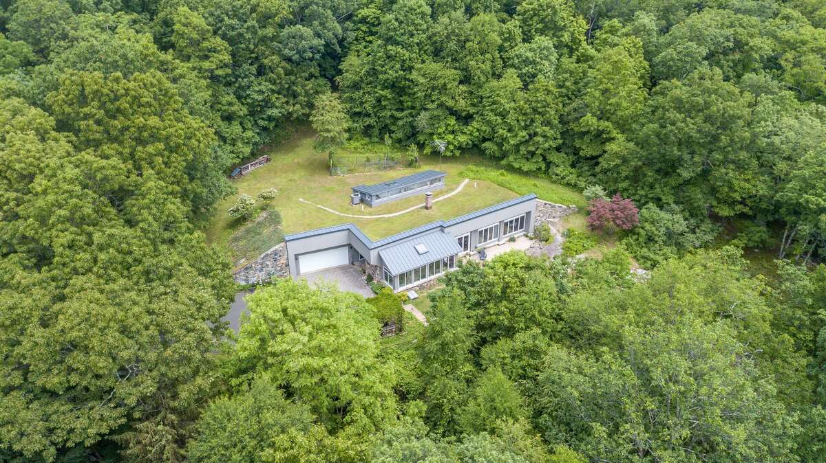 The home on 11 Pine Hill Road in New Fairfield, Conn. sits on over 11 acres of land. View listing
