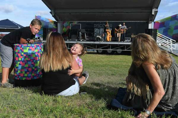 Families spread across the lawn at the Event Centre to enjoy the opening night of Beaumont's Sundown Summer Concert Series Wednesday. Photo made Wednesday, June 9, 2021 Kim Brent/The Enterprise