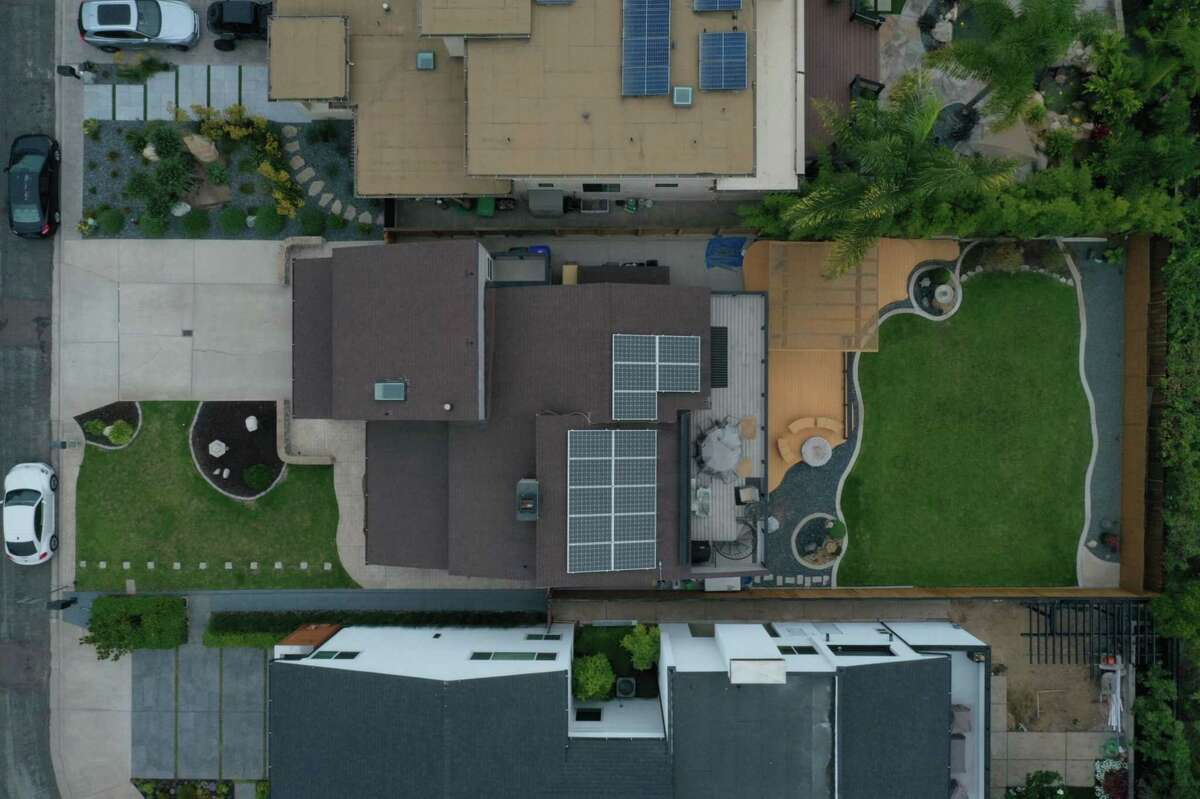 A single-family home with rooftop solar panels is seen in this aerial photograph taken over Del Mar, Calif., on Sept. 2, 2020.