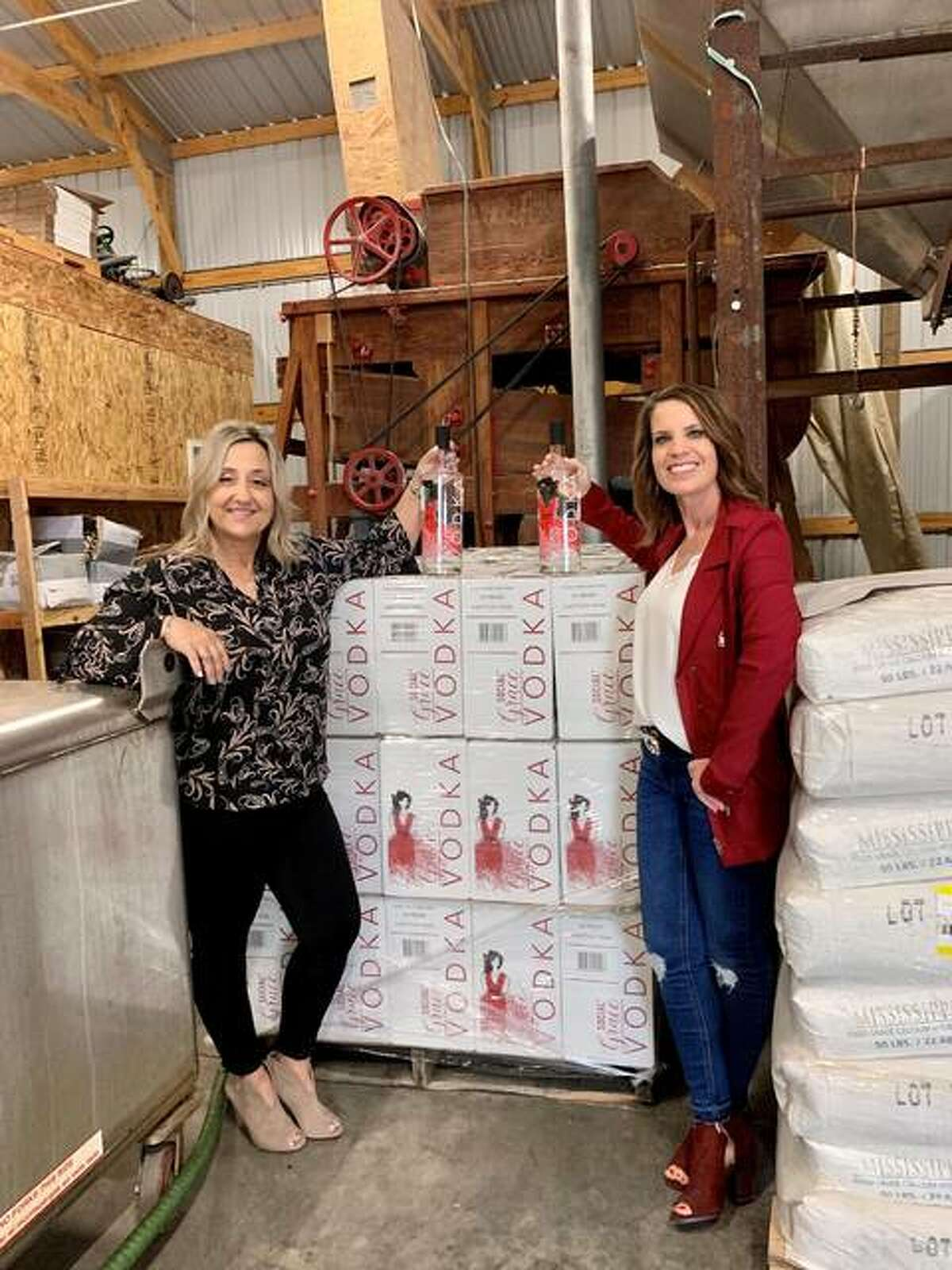 Co-Owners Denise Arendell left, and Christa Guilbeault with their new Social Grace Vodka.