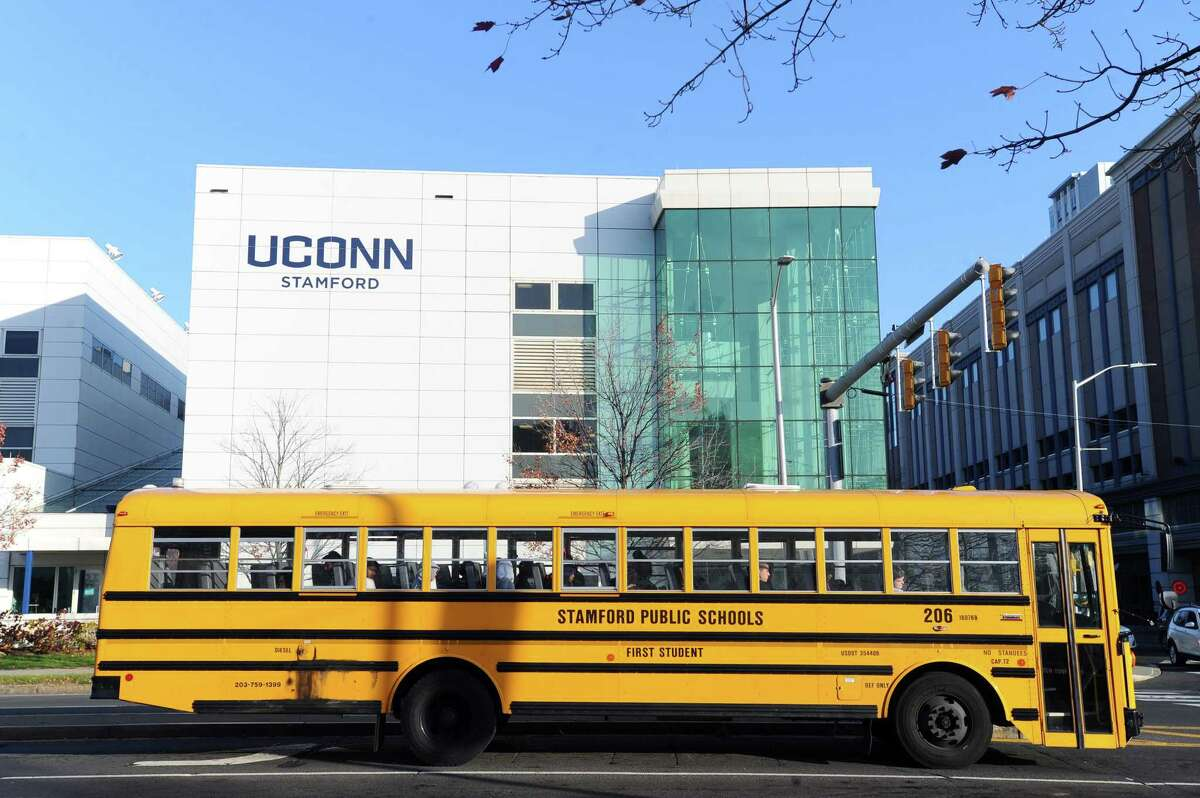 A Stamford public school bus drives past UConn Stamford in downtown Stamford.