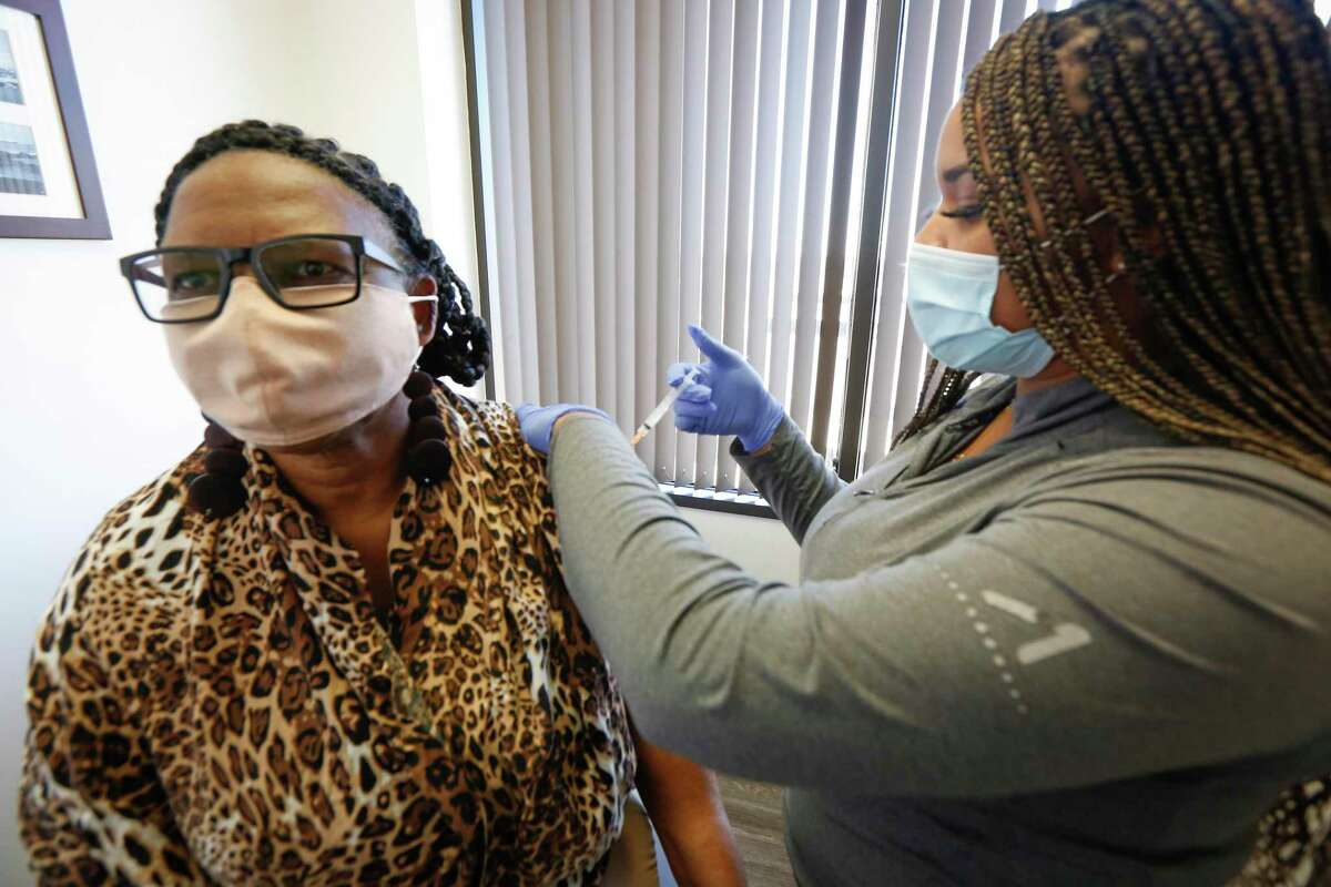 Xandra Williams-Earlie receives her flu shot by Candace Mabins in Dr. Gary Sheppard office Oct. 30 in Houston.