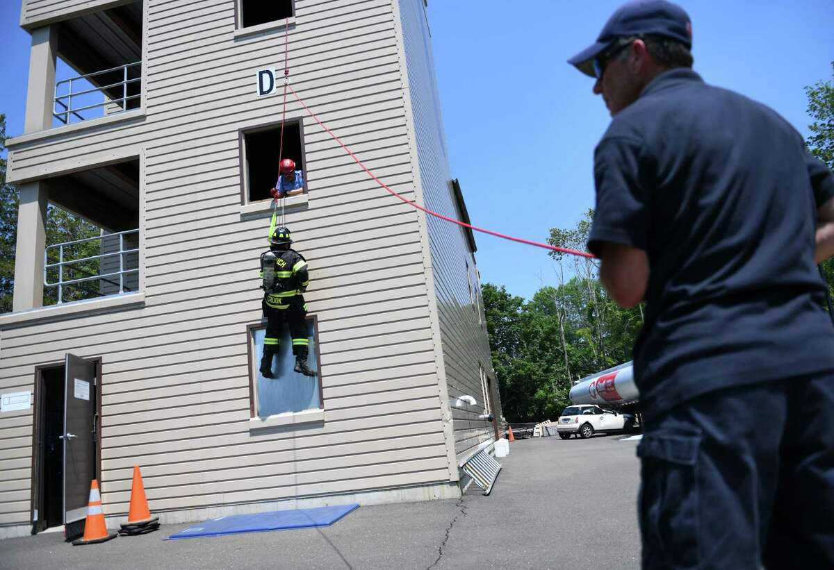 Greenwich Fire Department recruit Ryan Crook pratices rope descents at the fire training facility in Greenwich, Conn. Monday, June 7, 2021. Five new recruits began a seven-week training program Monday after just completing a 17-week state training session in Windsor Locks.