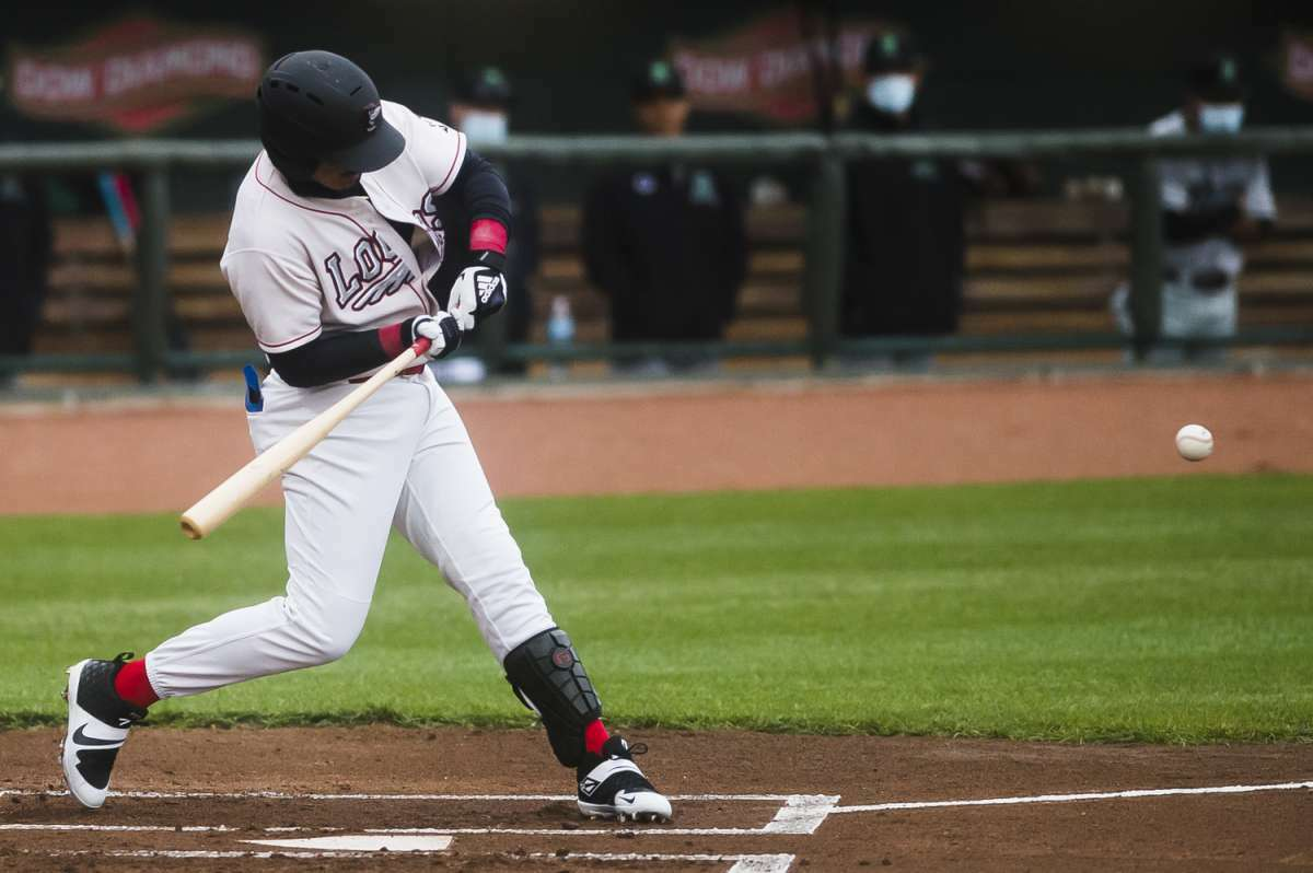 Great Lakes Loons infielder Miguel Vargas swings on a pitch during the Loons' opening day game against Dayton Tuesday, May 4, 2021 at Dow Diamond in Midland. (Katy Kildee/kkildee@mdn.net)