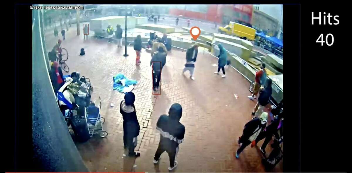 Screen captures of surveillance camera footage purporting to show Steven Jenkins being surrounded and hit by several individuals shortly before Jenkins attacked Xiao Zhen Xie, an older Asian woman on Market Street in San Francisco.