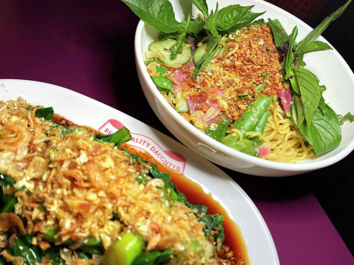 The menu includes the Chinese broccoli dish gai lan with oyster sauce, foreground, and miso ginger noodles with veggies and peanuts at Best Quality Daughter at the Pearl.