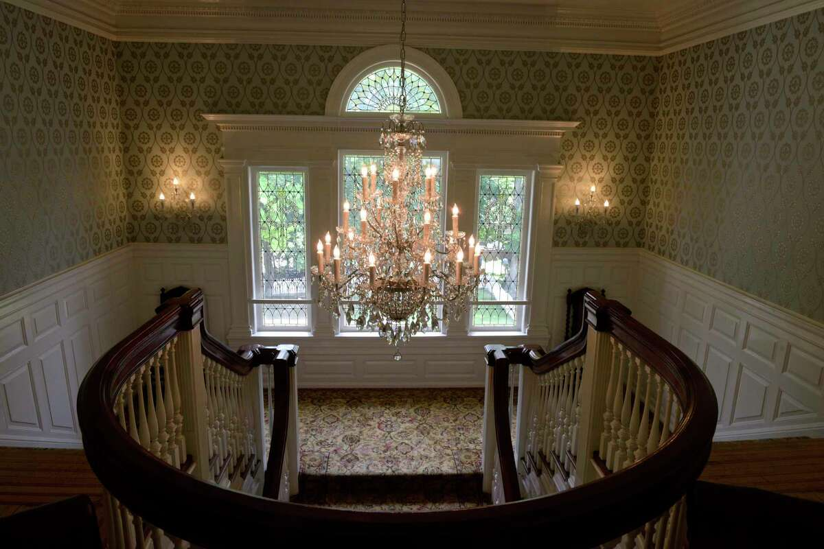 The main staircase of Lounsbury House, which is celebrating its 125th anniversary this year. The house, built in 1896 by former Connecticut Gov. Phineas C. Lounsbury, is a national historic site. It is a replica of the Connecticut State building in the 1893 Chicago World's Fair that Lounsbury built to serve as his family home.