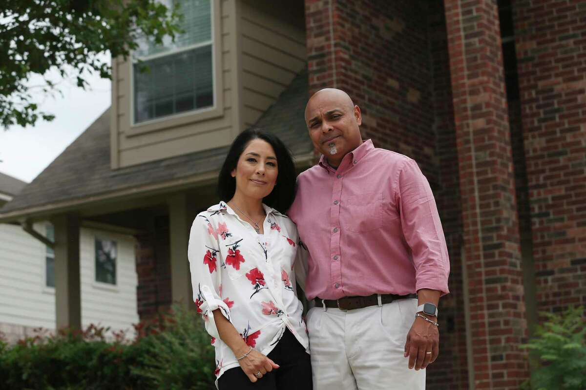 Rosalinda Montero and Rigoberto Montero at their home in New Braunfels. The couple contracted to build their dream home on an acre lot but the deal was terminated after they declined to pay about $50,000 more for the home to cover the rising cost of construction materials.