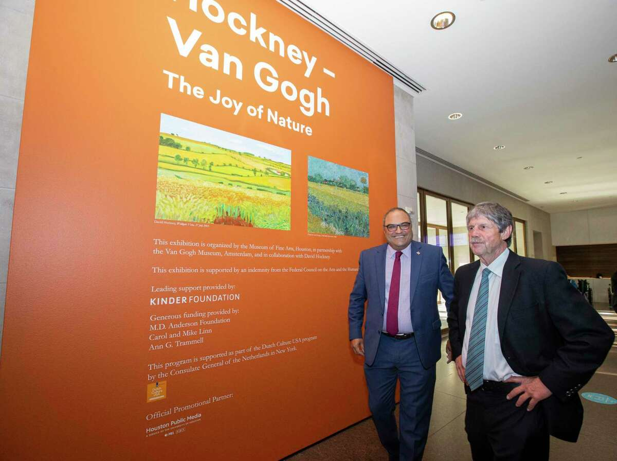 British Consul General Richard Hyde and Rice University Baker Institute Faculty Scholar Jim Blackburn head to view the Hockney-Van Gogh exhibit Wednesday, June 9, 2021,Museum of Fine Arts, Houston in Houston. People from Baker Institue and the British Consulate were celebrating a new partnership related to carbon storage. Paintings from the exhibition depict some of the lands in Yorkshire, England, where they hope carbon will be stored.