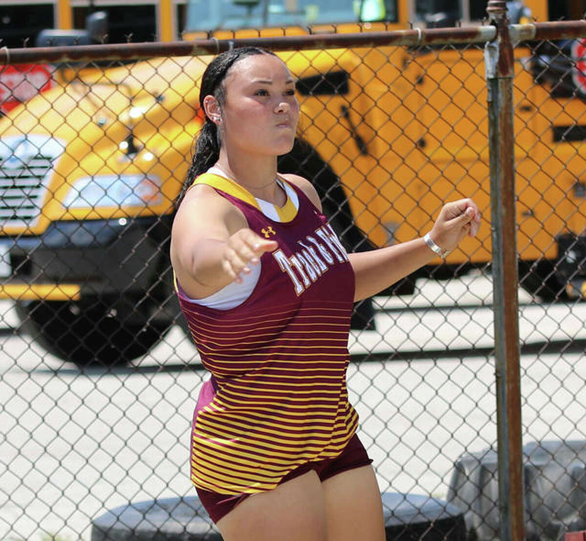 EA-WR senior Jayden Ulrich watches her throw in the shot put at the EA-WR Class 2A Sectional last Friday in Wood River. With state-record throws in both events this season, Ulrich is favored to win state titles in both the shot and discus in Friday's Class 2A state meet in Charleston.