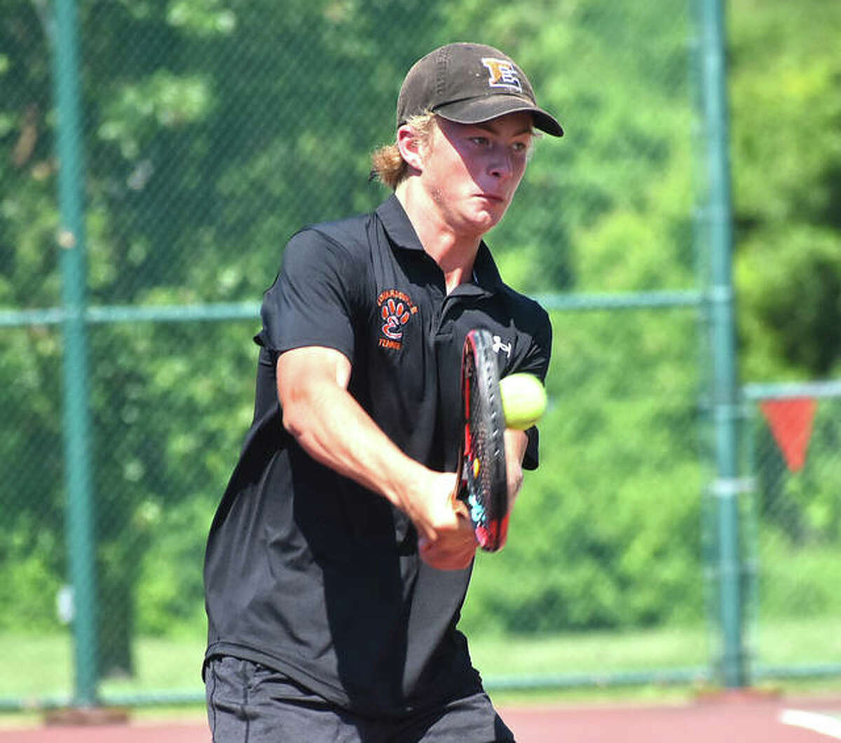 Edwardsville's Colton Hulme hits a return shot during his singles match in the Class 2A Belleville West Sectional semifinals on Saturday in Belleville.
