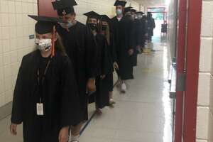 These Shelton High seniors returned to their old elementary school - Sunnyside School - earlier this week.